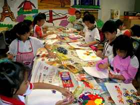 Pupils in the Art Club engaged in art activiities.jpg